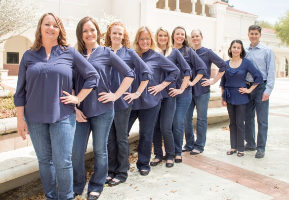 an excellent team outside posing and smiling Ossi Orthodontics Jacksonville and St. Augustine Florida Orthodontist